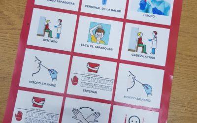 Entrega de la guía de anticipación en hisopado con pictogramas